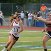 JIM VAIKNORAS/staff photo Newburyport's Margaret Cote is guarded by Ipswich's Meghan O'Connor at Peabody High School Friday night. Newburyport defeated Ipswich 15-11 claiming the Div North Championship.