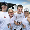 BRYAN EATON/Staff photo. Susan Hines flanked by Michael Kennefick, left, his brother Jake and their mother, Mary Lee. The brothers are part of the training group Hines runs called The Couch to 5K and the two ran in the race.