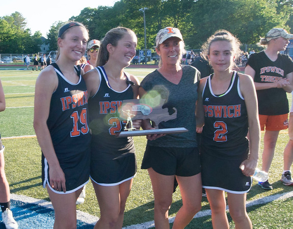 JIM VAIKNORAS/staff photo  Ipswich captains Julia Glavin, Delaney Whooley coach Kerri O'Connor and Kelsey Daly hold the runner up trophy at Peabody High School Friday night. Newburyport defeated Ipswich 15-11 claiming the Div. North Championship.