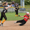 BRYAN EATON/Staff photo. Amesbury's Madison Napoli is forced out at second on a single by Mikayla Porcaro.