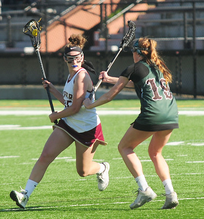 JIM VAIKNORAS/staff photo Newburyport's Cescily Wheeler makes a move on Austin Prep's Lauren Joyce at World War Memorial Stadium in Newburyport Wednesday.