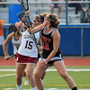 JIM VAIKNORAS/staff photo y Ipswich's Meghan O'Connor fights for the ball with Newburyport's Cescily Wheeler at Peabody High School Friday night. Newburyport defeated Ipswich 15-11 claiming the Div North Championship.