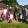 BRYAN EATON/Staff photo. Volunteers of the Nourishing the North Shore hen house collect eggs to give to food pantries.