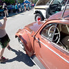 JIM VAIKNORAS/Staff photo Jason Raymond, 8, of Salisbury takes a photo of a 1960 VW beetle owned by Tony Lapanne of Portsmouth at the Amesbury car show in Market Square Sunday morning.