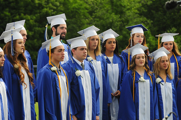 JIM VAIKNORAS/staff photo The Senior Chorus performs the National Anthem at Georgetown's Commencement at Perley School Field Saturday