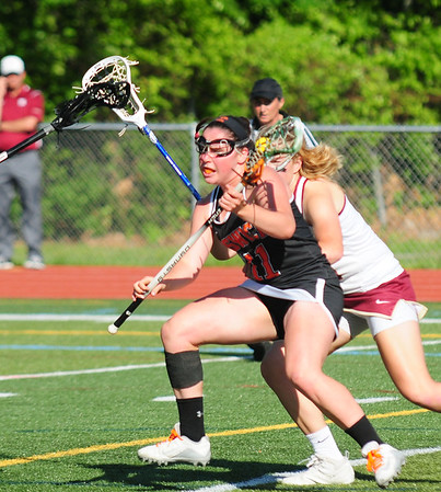 JIM VAIKNORAS/staff photo  Ipswich's Annie Gillis advances the ball against Newburyport at Peabody High School Friday night. Newburyport defeated Ipswich 15-11 claiming the Div. North Championship.