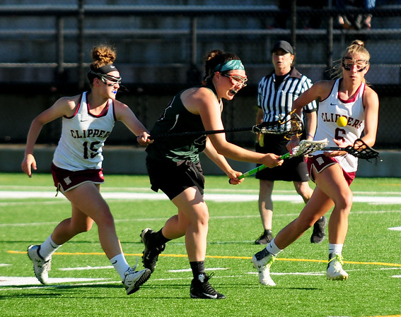 JIM VAIKNORAS/staff photo Newburyport's Cescily Wheeler #15 and Molly Rose Kearney #6 defend against Austin Prep's Maggie Barden during their game at World War Memorial Stadium in Newburyport Wednesday.