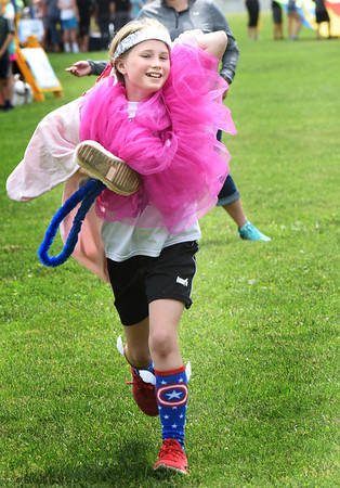 BRYAN EATON/Staff photo. Emerson Leahy, 10, competes in the Pretty in Pink relay at Field Day at the Upper Molin Elementary School in Newburyport.