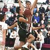 JIM VAIKNORAS/Staff photo Pentucket's Peter Lopata goes up for a lay up against Newburyport's Casey McLaren Monday at Newburyport High School.