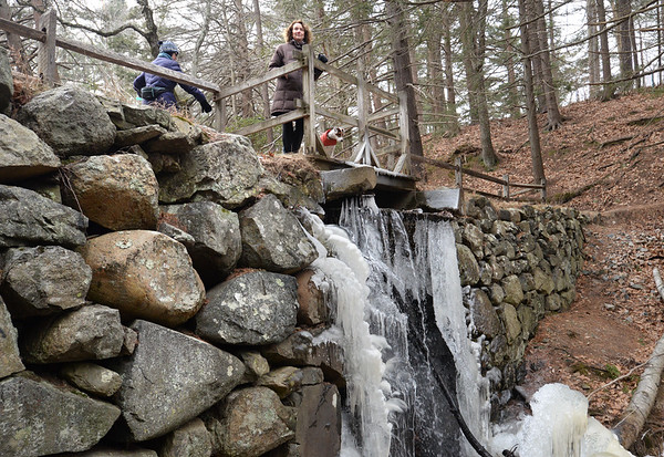 BRYAN EATON/Staff photo. Marlys Edwards atop the dam at Maudslay State Park which is slated for restoration.