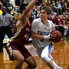 JIM VAIKNORAS/Staff photo  Triton's Max McKenzie drives to the basket guarded by Parker McLaren at Triton Friday night.