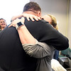 BRYAN EATON/Staff photo. Jackie Ames hugs Newburyport Police officer Eric Marshall who was first on scene last year when she had a heart attack at home, and was part of responders credited with saving her life.