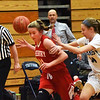 BRYAN EATON/Staff photo. Amesbury's Avery Hallinan loses the ball as Triton's Emily Colby puts on the pressure.