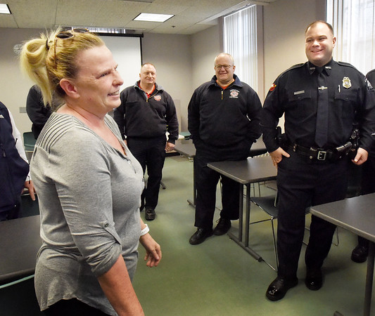 BRYAN EATON/Staff photo. Jackie Ames meets with first responders who  saved her during a heart attack last year including Newburyport police officer Eric Marshall, right, who was first on scene at her home
