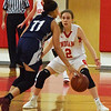 BRYAN EATON/Staff photo. Ciara Sullivan defends against Lawrence's Yarleen Betances.