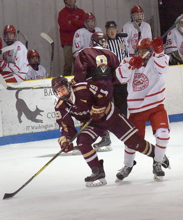 BRYAN EATON/Staff photo. Newburyport's Michael Twomey has his eye on the puck as a Masconomet player moves in.