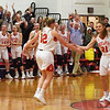 BRYAN EATON/Staff photo. Teammate Allison Napoli, right, congratulates Flannery O'Connor on her 1,000th point Wednesday night while playing Lawrence High School.