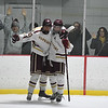 JIM VAIKNORAS/Staff photo Newburyport's Ben Reynolds and Patrick Leary celebrate Reynold's first period goal against Amesbury at the Graf Rink in Newburyport Friday.