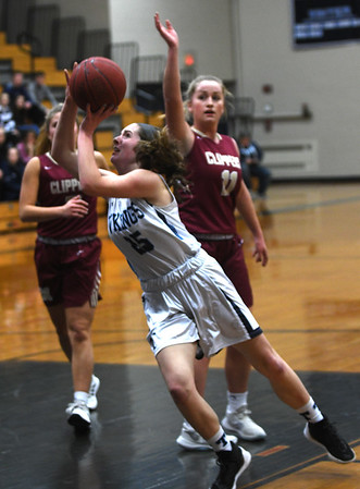JIM VAIKNORAS/Staff photo Triton's Colleen McCarthy glides to the basket against Newburyport at Triton Friday night.