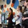 "BRYAN EATON/Staff photo. Several Newburyport High School students returned to the Nock Middle School to present to area educators the work they did on the ""I Am We"" civics projects.. Presenting from left, Elena Ambrose, 14, who did Plum Island Beach Pollution; Emily Fuller, 14, on Hunger in the Community and Sara Bovee, 14, on Sexual Harrassment Prevention."
