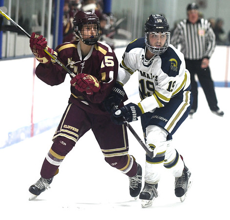 JIM VAIKNORAS/Staff photo Newburyport's Tyler Koglin fights for position with St Mary's Jared Coppola at Connery Rink in Lynn Wednesday night.