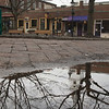 JIM VAIKNORAS/Staff photo The Unitarian Church is reflected in a puddle on Inn Street in Newburyport Sunday afternoon.