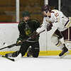 BRYAN EATON/Staff photo. Newburyport's Ben Reynolds moves the puck past a Pentucket defender.