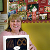 "BRYAN EATON/Staff photo. Pat Perry is closing her Carriagetown Chocolates shop in Amesbury after almost 14 years in business. What she'll miss most is her ""kids"" in photos above, all the youngsters who would frequent her shop which sold candy as well."