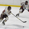 JIM VAIKNORAS/Staff photo Newburyport's Michael Twomey,#19, and Robert Johnson advance the puck against St Mary's at the Graf Rink in Newburyport Saturday.