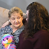 JIM VAIKNORAS/Staff photo Judy Adams, left, talks with Chalis Barrett in Brentwood NH Friday. The Chalis's daughter Madison was killed in an automobile accident this past summer and her heart was transplanted into Adams. The teddy bear they are holding contains a recording of Madison's heart beat.