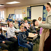 BRYAN EATON/Staff photo. Malka Benjamin shows off a mug with three handles to students at the Amesbury Elementary School. The presenter from Plimouth Plantation was teaching third-graders about life in early America.