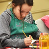 BRYAN EATON/Staff photo. Delaney Sargent, 9, decorates a frame with watercolors in the art room at the Boys and Girls Club in Salisbury. In the next class she will draw her subject in the frame likely a cute animal which are her favorites.