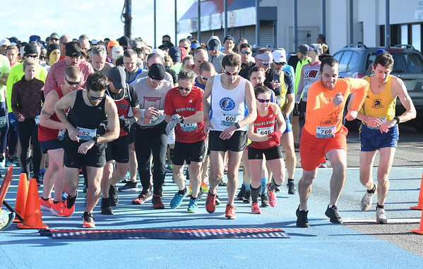 JIM VAIKNORAS/Staff photo Runner take off at the start of the 10k race at the Hangover Classic at Salisbury Beach Tuesday.