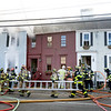 BRYAN EATON/Staff photo. Firefighters from surrounding communities aided the Newburyport Fire Department to battle a blaze that started in the building at left.