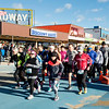 JIM VAIKNORAS/Staff photo Runners in the 5k race take off at the start of the Hangover Classic at Salisbury Beach Center Tuesday.