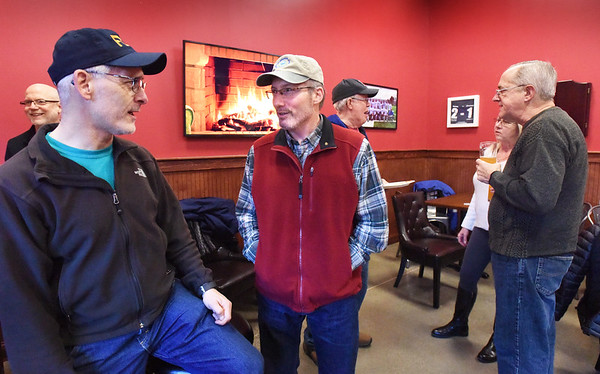 BRYAN EATON/Staff photo. Riverwalk was the site of an informal get-together in support of furloughed federal workers, their families, government contractors and others affected by the 3-week federal government shutdown. FDA engineer Joe Teixeira, left, chats with organizer and EPA employee Hugh Martinez on Friday afternoon.