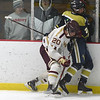 JIM VAIKNORAS/Staff photo Newburyport's Jacob Grossi-Hogg checks St Mary's Owen Maguire at the Graf Rink in Newburyport.