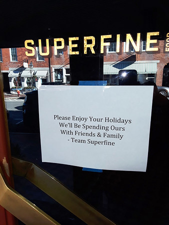BRYAN EATON/Staff photo. The sign has been on the door of Superfine Foods on State Street in Newburyport for several weeks.