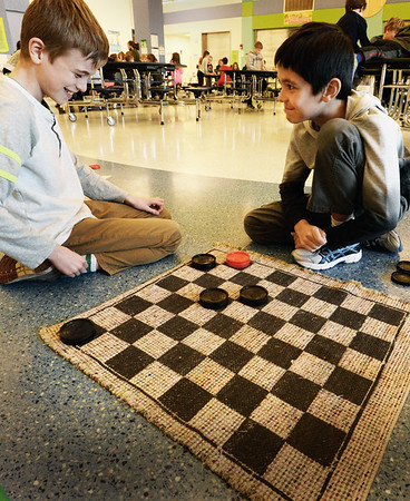 BRYAN EATON/Staff photo. Finn Deveney, 9, left is informed by Tyson Finnell, 9, that he's trapped in a game of chess, and admitted he hasn't played in awhile so was a little rusty. The two were at the Newburyport YWCA Afterschool Program at the Bresnahan School.
