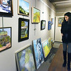 BRYAN EATON/Staff photo. Erin Becker, Executive Director, Cambridge Art Association was the juror for this show.
