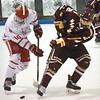 BRYAN EATON/Staff photo. Masco's Logan Campbell and Newburyport's Ryan Archer battle for the puck.