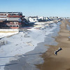 BRYAN EATON/Staff photo. Hotels and homes on Central Avenue at Salisbury Beach, left, could lose property value as sea levels rise.