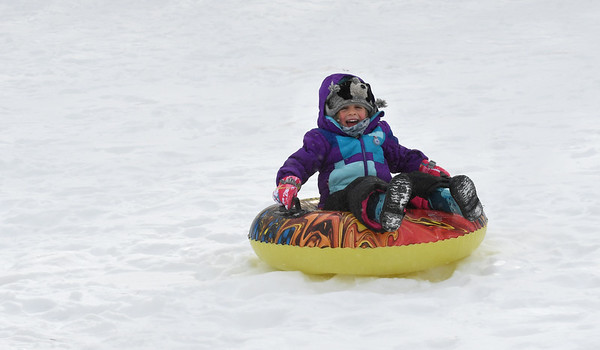 JIM VAIKNORAS/Staff photo Poppy Ward, 4, doesn't seem to mind the single digit temperatures as she sleds on Marches Hill in Newburyport Monday morning.