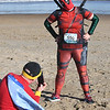 JIM VAIKNORAS/Staff photo Molly Tomlinson of Somerville, dressed as Deadpool, has her photo taken by Mark Kriegsman of Alington, dress as Wonder Woman the Hangover Classic at Salisbury Beach Tuesday.