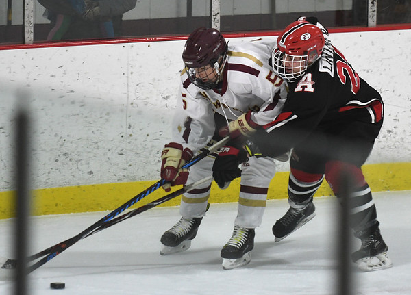 JIM VAIKNORAS/Staff photo Newburyport's Steven Jean fights for the puck with Amesbury's Ethan Lintner at the Graf Rink in Newburyport Friday.
