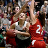 JIM VAIKNORAS/Staff photo Pentucket's Mackenzie Currie drives past Masconomet's Callie McSweeney and Paige Richardson at Pentucket Friday night.
