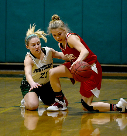 JIM VAIKNORAS/Staff photo Pentucket's Maddie Doyle fights for a loose ball with Masconomet's Mak Graves at Pentucket Friday night.