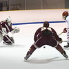 BRYAN EATON/Staff photo. Andrew Gotts gets the puck past Newburyport goalie Jackson Marshal in the first period.