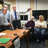 BRYAN EATON/Staff photo. Bob Merry waves to those in attendance as Rowley selectmen gave him a proclamation Monday night for his years of service to the town, on that board, the light commission, police department and many other organizations. From left, Selectmen Joseph Perry, Clifford Pierce and David Petersen, Merry, his wife, Geneva, daughter Pamela McKenzie and son, David.