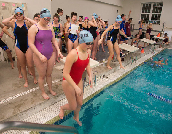 JIM VAIKNORAS/Staff photo Swimmer from the Triton swim team jump in the pool at the YWCA in Newburyport Friday night for their annual Swim-A-Thon fund raiser. The swimmer break up into smaller teams and compete to see who can complete the most laps in 45 min.